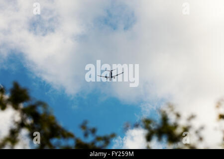 Jet flying in distance - Stock Image
