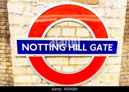 London Underground sign, London Underground Notting Hill Gate sign, Notting Hill Gate underground station sign, Notting Hill Gate underground station - Stock Image