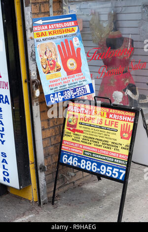 Signs on 74th St. in Little India for astrologer Sai Krishna with a 100% guarantee that he can fix all your troubles and see the past & future. NYC - Stock Image
