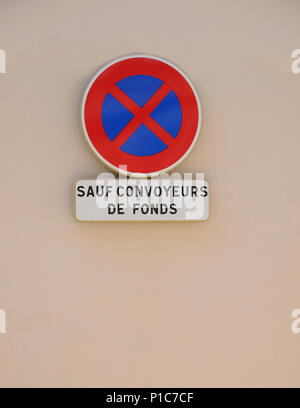 Traffic sign reading SAUF CONVOYEURS DE FONDS forbidding traffic to stop except for vehicles delivering funds of money to bank  TRAFFIC SIGN SAUF CON - Stock Image