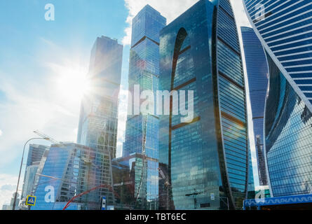 Moscow skyscrapers against the sky with the sun setting for them - Stock Image