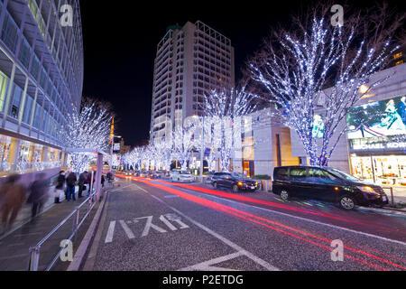 Long exposure of Keyakizaka with people waiting and parking cars during Christmas illumination at night, Roppongi, Minato-ku, To - Stock Image