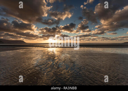 Sunset over the North Wales coast from Llandudno West Shore - Stock Image