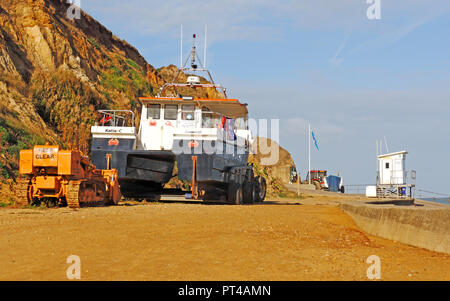 Fishing boats and lifeguards hut on high standing above the beach in North Norfolk at West Runton, Norfolk, England, United Kingdom, Europe. - Stock Image