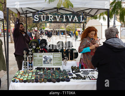 Survivalists running a Survivalism stall at an outdoor market, Plaza de la Merced, Malaga Andalusia Spain Europe - Stock Image