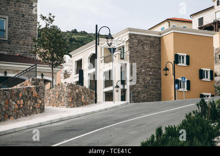 Beautiful view of a modern residential area or district. Residential buildings and the road. - Stock Image