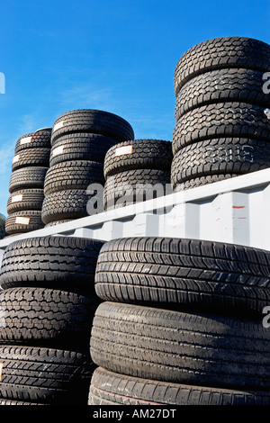 old tires, piles, in a row, transportation, tires, tread, rubber, old, retread, for sale, usable, junk, junk yard, - Stock Image