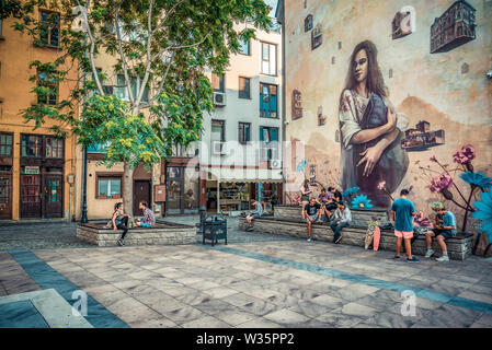 Young group of people in small square inside  Kapana district in city of Plovdiv, Bulgaria - Stock Image