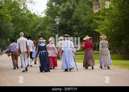 People in costume walk at Williamsburg, Virginia, USA - Stock Image
