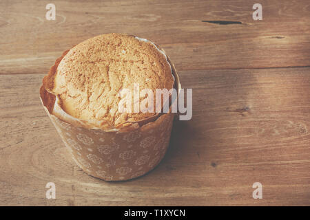Homemade egg cupcake put on left of wooden table - Stock Image