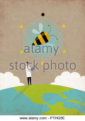 Scientist researching bees on top of the globe - Stock Image