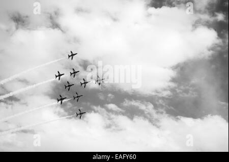 Red Arrows flying display at Malta International Airshow 2014, Flanker Bend formation - Stock Image