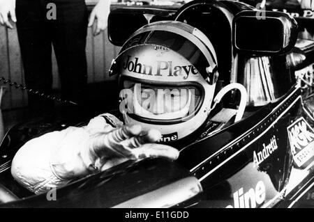 Racing Driver MARIO ANDRETTI seated in his John Player Special Lotus, before the start of the race which he won - Stock Image
