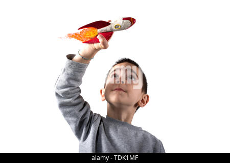 Child plays with a rocket. Concept of imagination. Isolated on white background - Stock Image