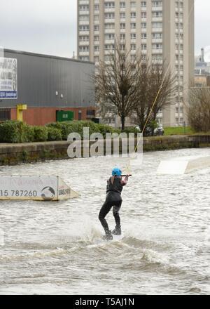 A teenage girl learning to wakeboard at Glasgow Wake Park, Port Dundas Canal,  Pinkston, Scotland, UK, Europe - Stock Image