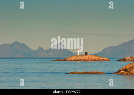 Lighhouse on a tiny island in the archipelago near Henningsvaer on Lofoten in northern Norway. - Stock Image
