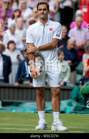 London, UK. 14th July 2019. Wimbledon Tennis Tournament, Day 13, mens singles final; A dejected Roger Federer (SUI) with his runners up trophy Credit: Action Plus Sports Images/Alamy Live News - Stock Image