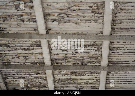 underside of a balcony with peeling white paint - Stock Image