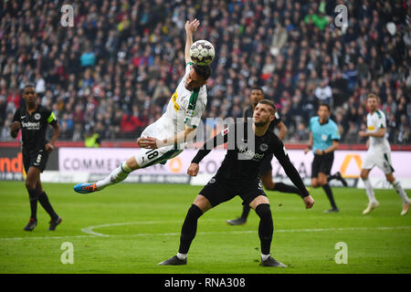 Frankfurt, Germany. 17th Feb, 2019. Josip Drmic (L) of Moenchengladbach vies with Ante Rebic of Frankfurt during the Bundesliga match between Eintracht Frankfurt and Borussia Moenchengladbach in Frankfurt, Germany, Feb. 17, 2019. The match ended in a 1-1 draw. Credit: Ulrich Hufnagel/Xinhua/Alamy Live News - Stock Image