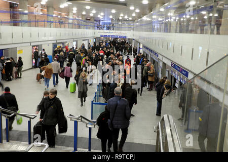 Passengers people commuters travellers buying tickets and walking inside Kings Cross railway station in London England UK  KATHY DEWITT - Stock Image