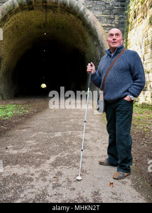 Ashbourne, UK. 2nd May, 2018. Blind British Armed Forces veteran Simon Mahoney at the entrance to Tissington Tunnel, Ashbourne, ahead of his book launch 'Descent into Darkness' which he wrote as an insight to the thousands who have & are losing their sight, their carers and professionals working in the eye care field. Credit: Doug Blane/Alamy Live News - Stock Image