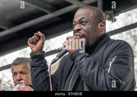 London, UK. 9th Dec, 2018. Weyman Bennett of Stand Up to Racism speaks at the rally by united anti-fascists in opposition to Tommy Robinson's fascist pro-Brexit march. The protest by both remain and leave supporting anti-fascists gathered at the BBC and marched to a rally at Downing St. Police had issued conditions on both events designed to keep the two groups well apart. Credit: Peter Marshall/Alamy Live News - Stock Image