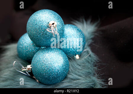 Holiday season can be difficult, scene set with blue round baubles and dark background - Stock Image