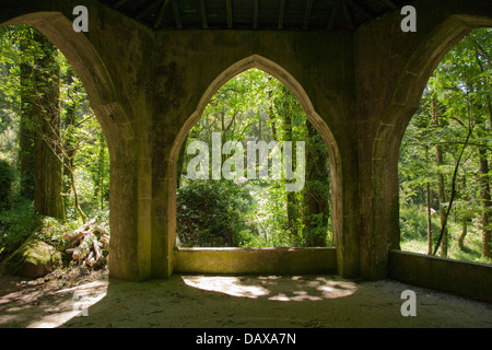 Sintra Gardens, Pena, Gothic arches of this folly frame the woodland beyond - Stock Image