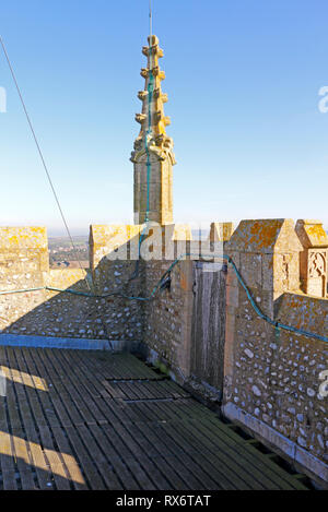 A pinnacle and access door at the top of the lofty tower of the parish Church at Blakeney, Norfolk, England, United Kingdom, Europe. - Stock Image