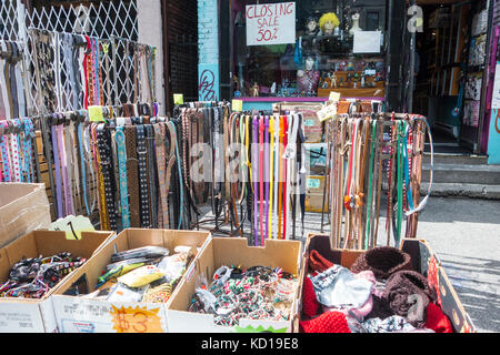 Belts,hats and other accessories on sale outside store that is closing on Baldwin St. in Kensington Market in downtown - Stock Image