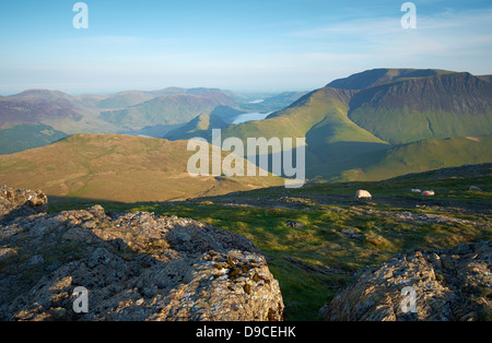 Sunrise over High Snockrigg from the summit of Robinson in the Lake District. - Stock Image