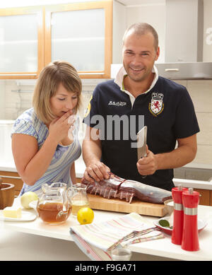 Man and Woman Cooking - Stock Image