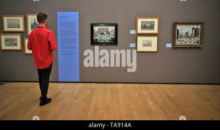 Backstreet Cricket in Salford by the artist LS Lowry goes on display for the first time in over 20 years at the Lowry in Manchester before it is to be auctioned by Sotheby's next month. - Stock Image