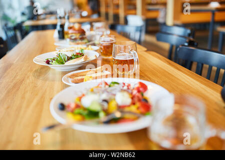 Various dishes on a table in a restaurant or bistro - Stock Image