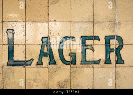 Tiles on the outside of a historic hotel (Pub) or bar in Surry Hills, Sydney advertise the type of beer available, Lager - Stock Image