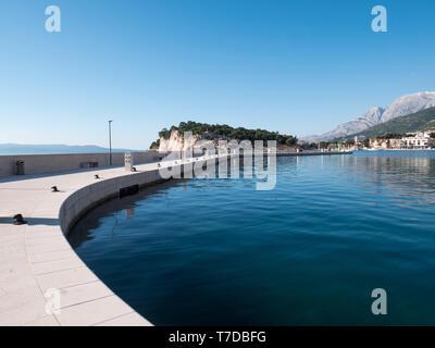 Harbor in Makarska city on sunny summer day - Stock Image