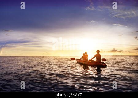 Family with child swims on kayak - Stock Image