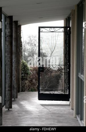 View through a doorway onto a foggy treed background. - Stock Image