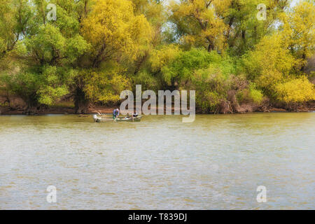 The Danube Delta Biosphere Reserve, Romania. April 20, 2019. Small-fishermen boat. There are over 45 species of fish in the numerous lakes and marshes - Stock Image