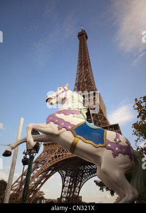 Carousel horse and the Eiffel Tower, Paris, France - Stock Image