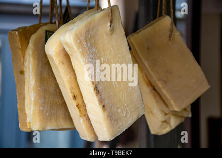 Hand made from natural ingredients and oils soap cutted from blocks hanging in shop, Provence, South of France, close up - Stock Image