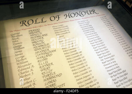 Roll of honour of police killed on duty and while serving displayed at The Thames Police Museum at Wapping Police - Stock Image