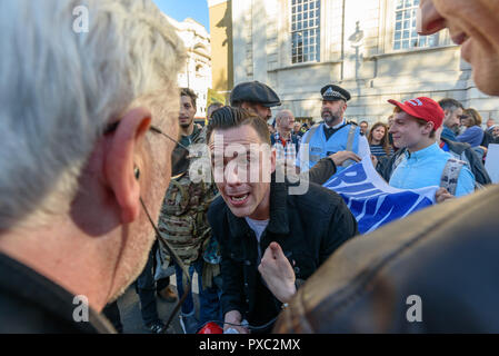 London, UK. 20th October 2018. One man cames to arge with the protests on Whitehall at the end of the People's Vote March calling for a vote to give the final say on the Brexit deal or failure to get a deal. They say the new evidence which has come out since the referendum makes it essential to get a new mandate from the people to leave the EU. With so many on the march the crowding meant many failed to reach Parliament Square and came to a halt in Whitehall. Peter Marshall/Alamy Live News - Stock Image