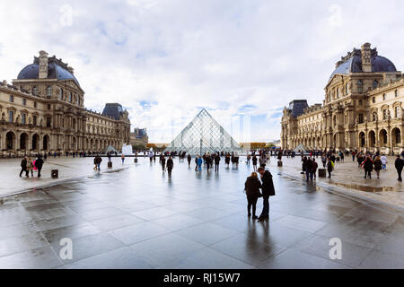 PARIS, FRANCE - NOVEMBER 10, 2018 - View of famous Louvre Museum and Pyramid in a winter and rainy day. Louvre Museum is one of the largest and most v - Stock Image