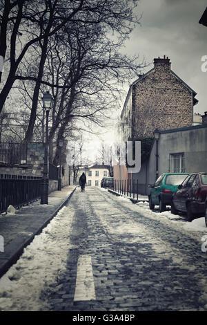 Little street in winter in Montmartre, Paris, France - Stock Image