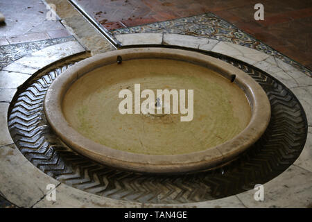 Spain. Seville. Alcazar of Seville.  Hall of Justice, 1340. Mudejar style. Detail of the fount. - Stock Image