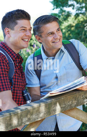 Father With Adult Son On Walk In Countryside - Stock Image