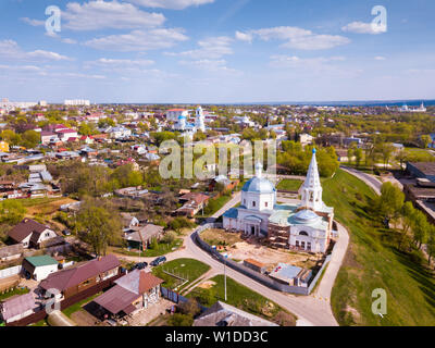 Aerial view of picturesque Serpukhov cityscape overlooking domes and bell towers of several temples, Russia - Stock Image