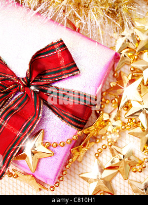 christmas gift with christmas decoration in gold - Stock Image