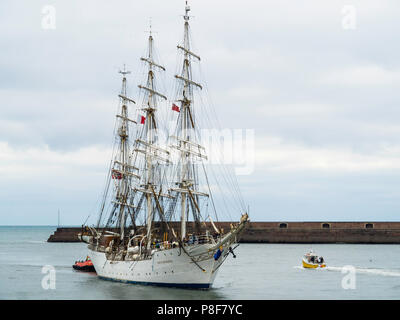 The Norwegian Full rigged three masted sail training ship Christian Radich arriving in Roker Harbour Sunderland for the Tall Ships Race 2018 - Stock Image